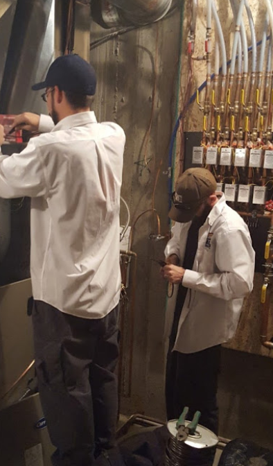 Dalco team technicians installing a new furnace