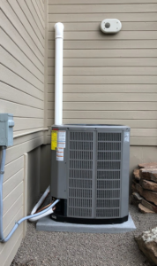 A new outdoor ac condenser unit installed by Dalco Heating & Air Conditioning