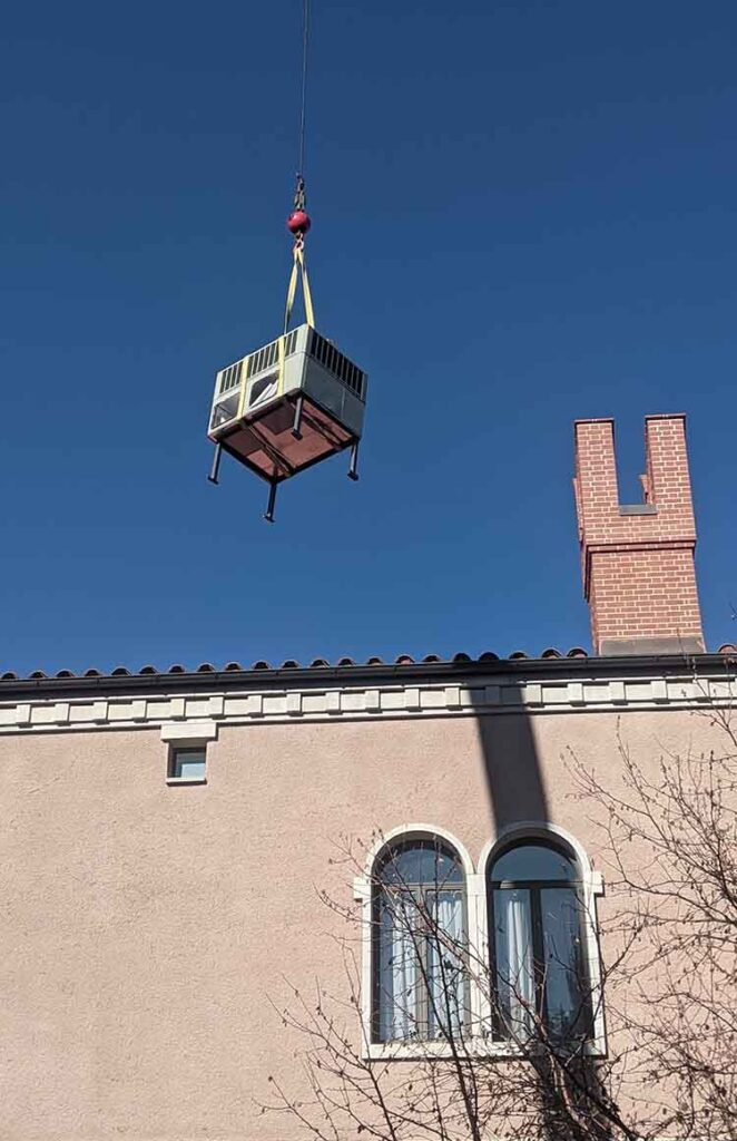 AC installation crane lift to roof of large Denver home