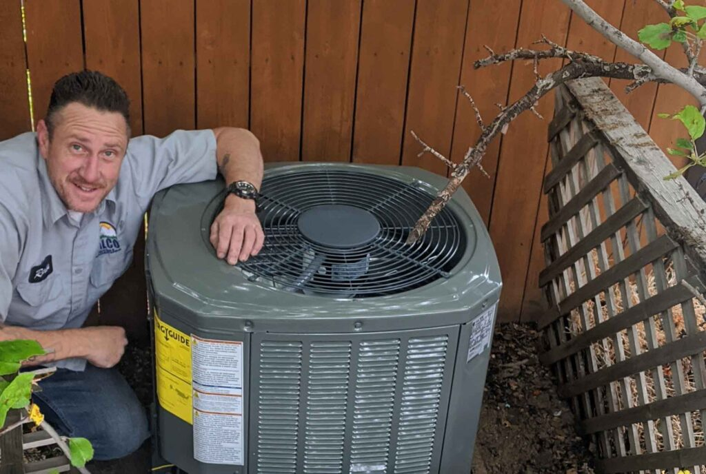 DALCO AC technician installing Trane air conditioner at a Denver home